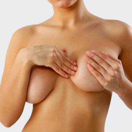 После овуляции может остаться боль в груди